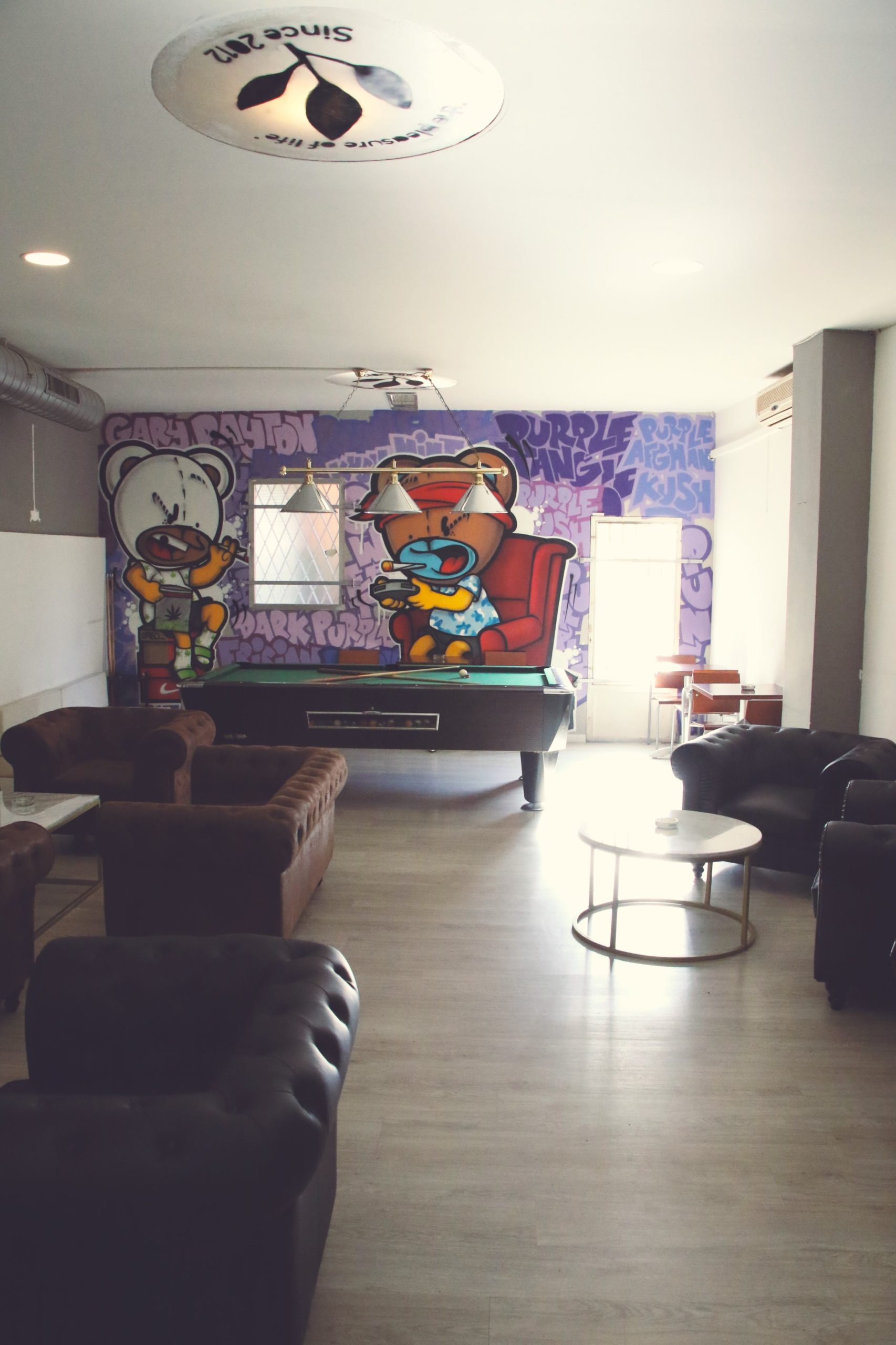 weed vice space with pool table chairs and tables